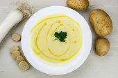 foto of italian parsley  - Italian potato and leek soup with olive oil parsley and croutons - JPG