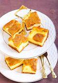 foto of cheesecake  - Pumpkin cheesecake bars  on plate selective focus - JPG