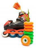 stock photo of roller-skating  - Roller March 8 tulip in stack of wheels and roller skates - JPG