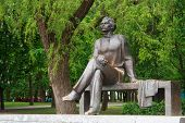 stock photo of maxim  - Monument to Maxim Gorky in Gorky park Belarus - JPG