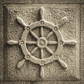 stock photo of rock carving  - rudder of a ship carved in the rock - JPG