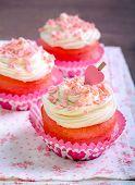 picture of red velvet cake  - Pink velvet cakes with cream topping on napkin  - JPG