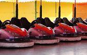 pic of car ride  - The Riding Cars on a Fun Fair Dodgem Attraction - JPG