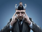 foto of crazy face  - Crazy man in the head of young businessman - JPG