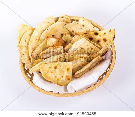isolated basket plate of flat bread. View from above.