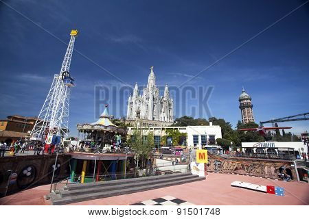 BARCELONA, SPAIN - MAY 2, 2015:  Amusement Park and Church of the Sacred Heart of Jesus on Mount Tibidabo in Barcelona, Catalonia, Spain