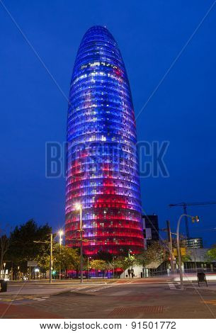 BARCELONA, SPAIN - MAY 5, 2015: Torre Agbar, Business tower at night in Barcelona, Spain.The tower was officially opened by the King of Spain on September 16, 2005 and at a cost of 130 million euros.