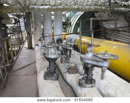 Old Rusty Industrial Steel Pipelines, Valves And Equipment At Power Plant