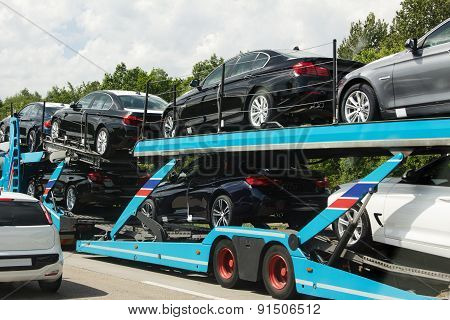 Transportation Of Brandnew Cars On A Auto Transporter