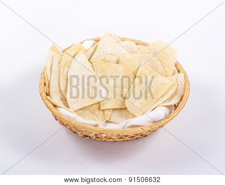 basket of flat white bread isolated on white background