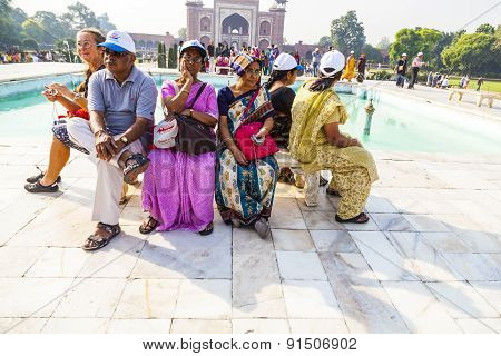 People Visit Taj Mahal In Agra And Have A Rest On A Bench, India