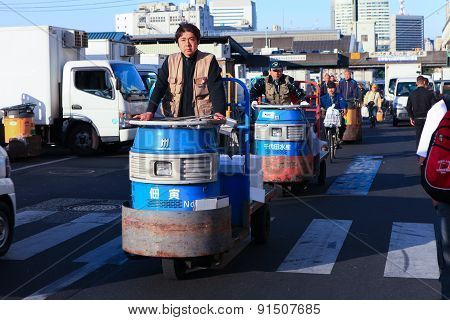Workers at Famous Tsukiji fish market operational area
