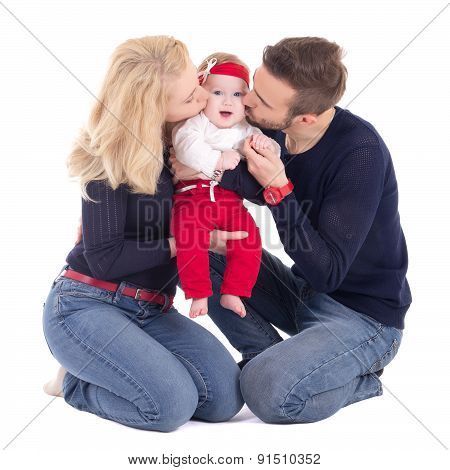 Happy Young Family - Father And Mother Kissing Little Daughter Isolated On White