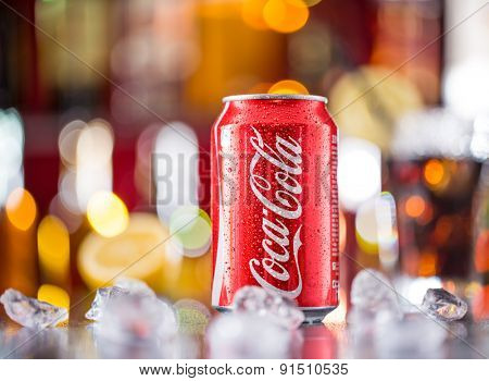 PRAGUE, CZ - APRIL 6, 2015: Can of Coca-Cola on bar desk, close-up. Coca-Cola Company is the leading manufacturer of soda drinks in the world.