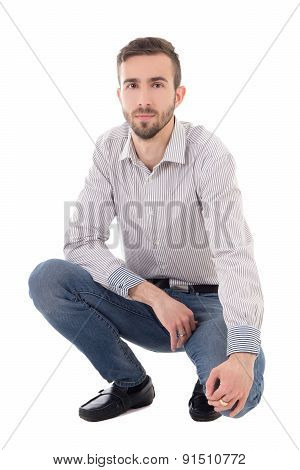 Portrait Of Handsome Man Sitting Isolated On White