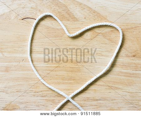 Heart Rope On A Wooden Background