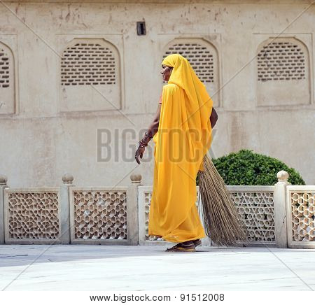 Woman Of Fourt Class In Brightly Colored Clothing Cleans The Palace In Amber
