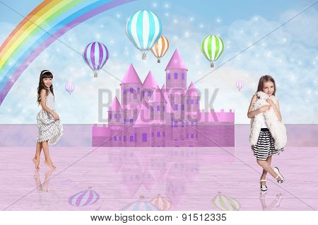 Two little girl in front of a pink fairy castle
