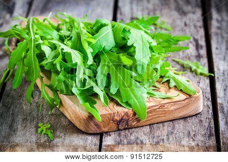 Fresh Organic Arugula On Cutting Board