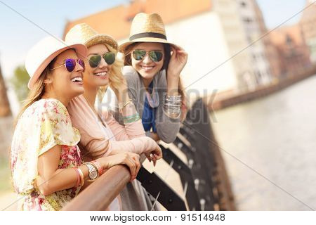 A picture of three friends hanging out in the city of Gdansk in Poland