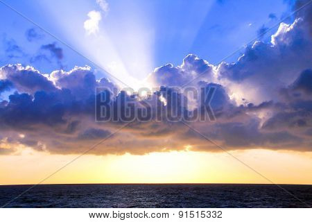 Beautiful Sunset Over Sea With  Majestic Clouds In The Sky
