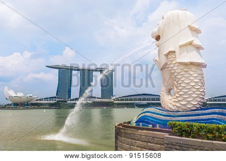 SINGAPORE-APRIL 30:The Merlion fountain and Marina Bay Sands Resort April 30 2015 in Singapore. Merlion is a mythical creature with the head of a lion and the body of a fish and is a symbol of Singapore.