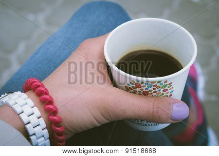 Girl In Blue Jeans Resting And Drinking Coffee Outdoor