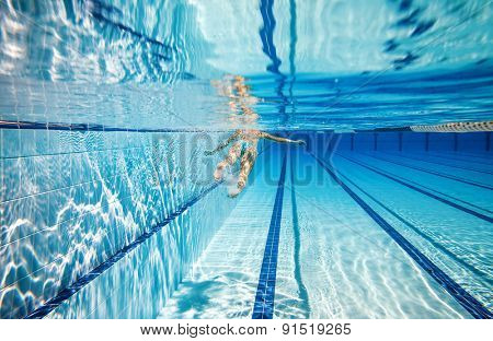 woman swimming in the poolin the pool under water