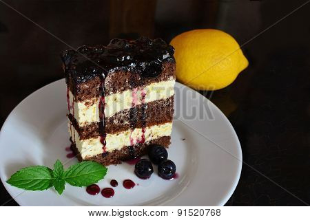 Cocoa Sponge Cake With Lemon Cream And Blueberry Sauce