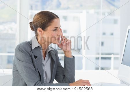 Concentrate businesswoman using computer in office