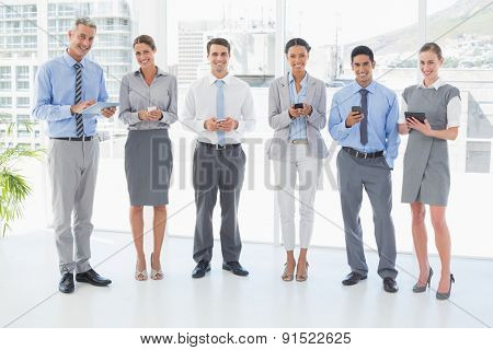 Business people using their phone in office