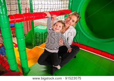 Mom And Daughter In Indoor Playroom