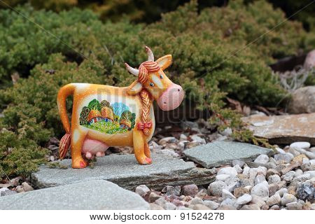 Cheerful Cow On A Stone Path