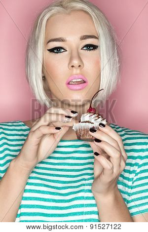 Fashion portrait girl with cake on pink background