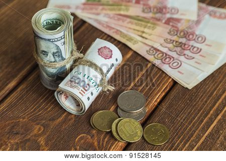 Dollars and rubles stack, coins on the wood desk