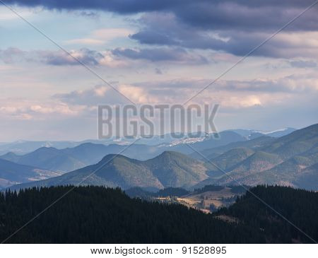 Spring landscape. Beautiful clouds over the mountains