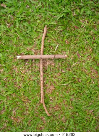 Simple Cross Against Green Background