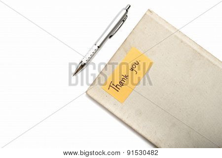 Thank You Card On Notebook And Pen