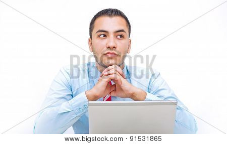 A Portrait Of A Young Businessman Lost In Thoughts Over White Background
