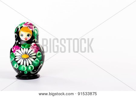 one dark russian doll isolated  on white background