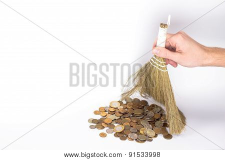 isolated broom in a man's hand and golden coins