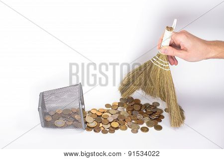 the man's hand sweeps the coins in basket