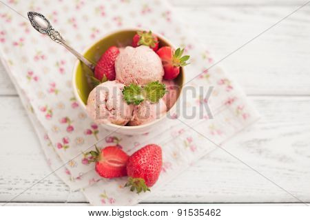 strawberry ice cream on wooden background