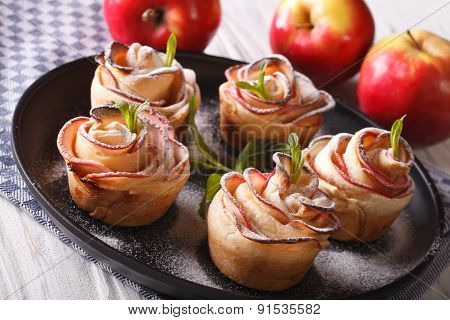 Cakes Rose Out Of An Apple Close-up On A Plate