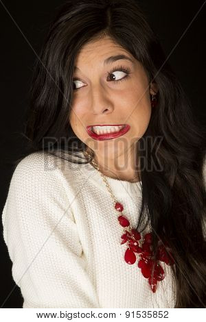Intense Teeth Gritted Facial Expression On A Dark Complected Woman
