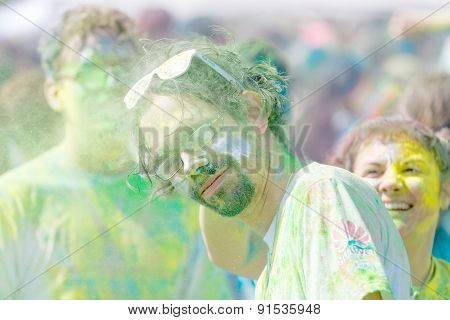Man Wearing Glasses And Beard Covered With Green Color Powder