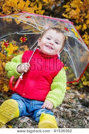 Autumn Portrait Of A Happy Kid Toddler