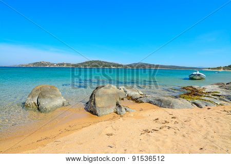 Rubber Boat And Rocks In Porto Pollo Beach