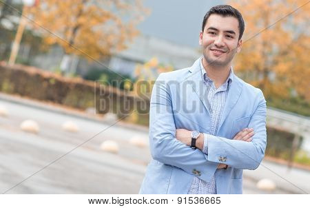 Smiling Bussinesman With Crossed Arms, Outdoor - Outside