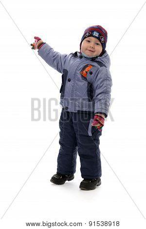 Three-year Boy In Winter Clothes